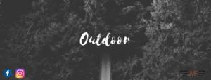 """Wald mit der Schrift """"Outdoor"""" im Vordergrund"""